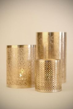 punched metal candle holders. I think these would make a nice, simple center piece for a wedding. I like the idea of lavender and gold, with white accents.