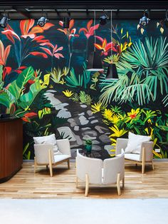 Arroyo Hotel — Buenos Aires | colourful mural backdrop to pale grey furnishings and pale timber floor.