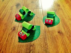 Paper craft red and green table decorations for a Very Hungry Caterpillar Party.