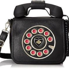 Retro Telephone Crossbody/Handbag with Aux Input Uniquely equipped with a functioning phone handle that plugs into your cell, with fully lined interior making for a purse that's tech-savvy and totally chic. Brand new. Never used. Zipper pocket inside and on the back. Betsey Johnson Bags