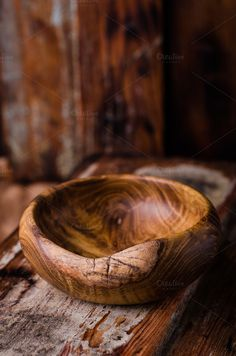 Wooden bowl on vintage background by tanchy on @creativemarket