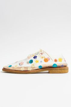 Clear floral print shoes from Anrealage.