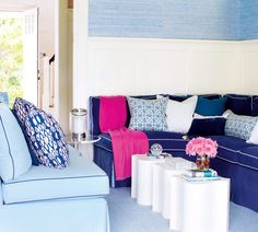 Hits of blue everywhere -- from the seating to the rug -- makes this sitting area a perfect fit for its Hamptons seaside home.