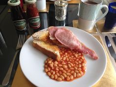 Breakfast with Tracklements Real Tomato Ketchup and Tracklements Fruity Brown Sauce Piccalilli, Brown Sauce, Ketchup, Chutney, Pickles, Mustard, Sausage, Bacon, Toast