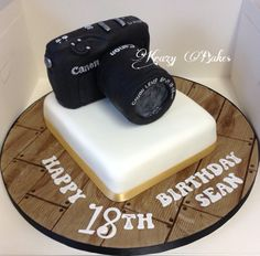 Canon camera 18th birthday cake with handmade and hand painted wooden look board