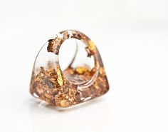 Hey, I found this really awesome Etsy listing at http://www.etsy.com/listing/110417222/resin-ring-copper-gold-flakes-square