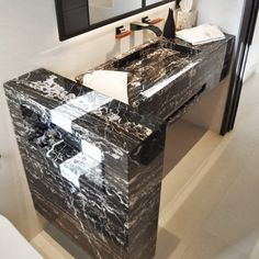 One of the recent projects we have carried out included the creation and installation of an ultra-light tailor-made black marble vanity. Below we describe the process from start to finish. Black Marble, Decorative Boxes, Vanity, Interior Design, Madrid, Projects, Miami, Barcelona, Strong