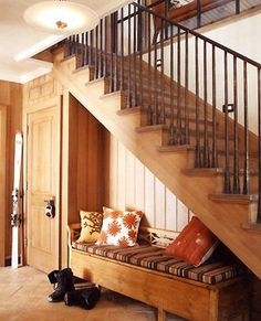 Stair tread flips up with concealed hinge to reveal storage underneath!