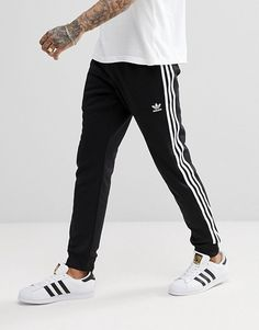 adidas Originals adicolor Superstar Joggers In Black. Casual style for men. Adidas Skinny Joggers, Adidas Joggers Outfit, Adidas Superstar Outfit, Pants Adidas, Black Joggers, Adidas Men, Nike Men, Track Pants Mens, Mens Jogger Pants