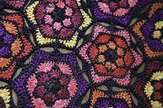 Frida Throw - free crochet hexagons blanket pattern by Yuli Nilssen on Nurturing Fibres. Pattern includes charts half hexagons and layout.