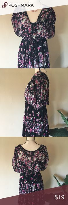 """Torrid Floral Print Dress, Size 14/16 This dress is such a flirt! The lightweight chiffon moves effortlessly with flutter sleeves, but maintains a flattering silhouette with a stretch fit-and-flare waistband. Poly blend; 38"""" in length.  In Excellent condition. Torrid Dresses"""