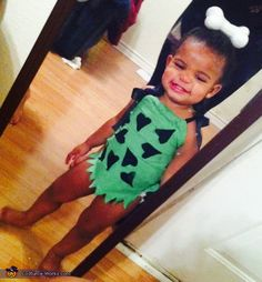 Charnece: My baby girl Adelynn is the beautiful baby pebbles from the flinestones. This costume is homemade that cost me a total of $9 for ribbon and fabric from hobby lobby....
