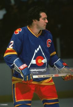 Canadian ice hockey player Joe Watson of the Colorado Rockies keeps an eye on the action during a road game, November Canadian Hockey Players, Ice Hockey Players, Hockey Goalie, Colorado Avalanche, Colorado Rockies, New Jersey Devils, American Sports, Hockey Cards, National Hockey League