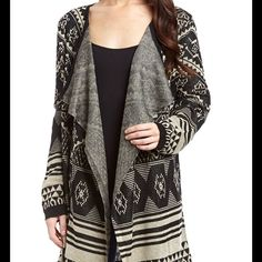 NEW ARRIVAL Shawl Collar Cardigan Meetu magic black and heather ivory shawl collar cardigan. 100% acrylic. Neutral tones polish this thigh brushing open duster, crafted from cozy and lightweight materials and finished with a drapibg shawl collar. Meetu Magic Tops