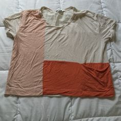 Colorblock top Worn plenty of times, its time to let go. Notice the rip in the second pic. Price reflects. Not from listed brand. Zara Tops