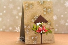 delightful card from Germany with the two step bird nestled in front of a birhouse decorated for Christmas and white embossed snowflakes falling in the kraft background...lovely!!