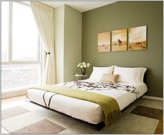Susan Kennedy Design This room in green and white colour seems very pleasant. It has walls in green with sepia style photos just above the headboard of the bed. The bedding is in white, green and wheat tones. The room is tiled that is looking well with the furniture. White curtains cascading over floor to ceiling windows are bringing vitality to this room.