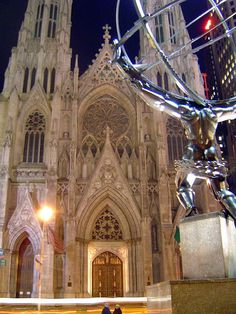 View of St. Patrick's Cathedral, New York with Lee Lawrie's colossal bronze Atlas statue in foreground.