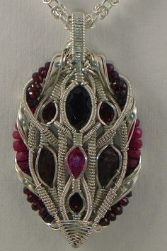 ruby, spessartine garnet, sterling silver wire wrap pendant, via Etsy. Wire Jewelry, Jewelry Crafts, Beaded Jewelry, Wire Bracelets, Wire Rings, Jewelry Tree, Silver Jewelry, Garnet Jewelry, Copper Bracelet