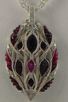 ruby, spessartine garnet, sterling silver wire wrap pendant.