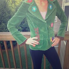 Green corduroy jacket Very unique and fun Kelly green jacket with peace and love patched on as well as flowers and birds. In excellent condition. Fully lined with a brown flowered lacy layer. 2 front pockets and 3 buttons to close. 96% cotton 4% spandex. Thanks for looking. Moon Jackets & Coats