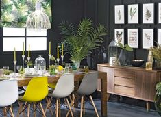 Something about this random yellow chair in a row of mixed grey neutrals spoke to me. :) Slate Grey Dining Room with Leafy Tropical Decor