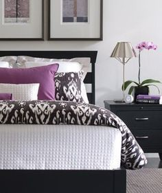 Beautiful Purple and Gray bedroom. Not precious at all. Love the combination of ikat print and square quilted coverlet.