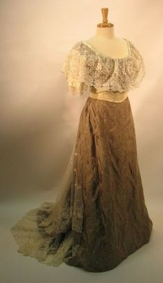 Custom made for a client by As They Sew In France studios, this is a very grand and elegant 1907 dinner and ball gown of celadon silk damask with embroidered sheer bertha and sleeves.