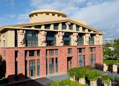 The main building, Team Disney Burbank, features the Seven Dwarfs holding up the roof as a nod to Snow White and the Seven Dwarfs, which held up the studio due to its tremendous success. | 15 Things You Learn When You Go On A Studio Tour At Disney