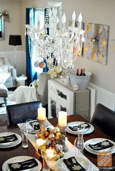 Dining Room Decorating Ideas for Christmas: Chandelier Over a Dining Table Ready for Christmas Dinner