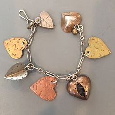 HP Mixed metals Thomas Mann heart bracelet This bracelet is a piece of art from New Orleans artist Thomas Mann.  This bracelet is from the 1980s. It is made of silver, nickel, brass and bronze. Thomas Mann Jewelry Bracelets