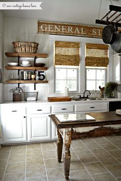 Love how this wooden sign above the kitchen windows matches the blinds