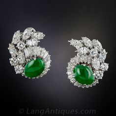 A matched pair of gorgeous green oval jades are augmented with resplendent platinum and diamonds in these magnificent, high-quality, platinum and diamond earrings, circa mid-twentieth century. The strikingly colorful gemstones are embraced by mirror-like Diamond Brooch, Diamond Studs, Diamond Jewelry, Diamond Earrings, Stud Earrings, Lotus Jewelry, Emerald Jewelry, Silver Jewelry, Antique Jewelry