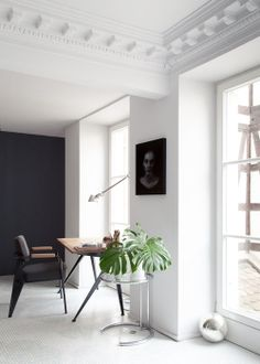 Beautiful decor. I could get so much done here. White minimal charcoal wall modern