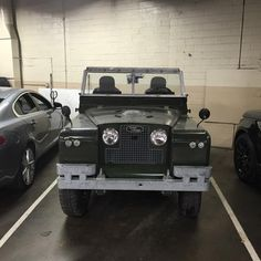Land Rover 88 Serie II soft top in parking.