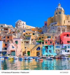 The island of Procida with its rainbow colors, Italy - Procida is the smallest island in the Gulf of Naples near Ischia and Capri and a perfect hideaway from the crowds. Known for its colorful houses, beautiful gardens and landscapes, this magnificent island is well worth your visit.