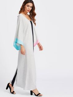 Long Sleeve Dresses. Maxi Tunic Designed with Scoop Neck. Natural Waist. Perfect choice for Casual wear. Striped design. Trend of Spring-2018, Fall-2018. Designed in Grey. Fabric is very stretchy.