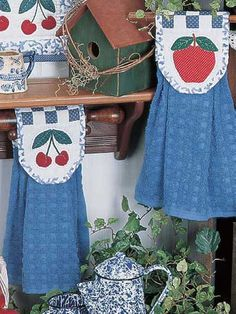 """Easily customize your kitchen towels with this free quilting pattern. Use fabric to create apples and cherries to make whimsical hand towels. They're just the thing to cheer up your kitchen decor! Size: 16"""" long.Skill Level: Intermediate"""