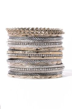 Amrita Singh Silver and Gunmetal 19 Piece Bangle Set. Stack them together, or wear a little at a time, either way this 19 piece bangle set boasts tons of style that will effortlessly transition your everyday ensemble. South Moon Under.
