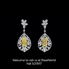 Dehres. A beautiful Pear Shape Fancy Yellow diamond dangling earrings totaling 28.80 carats in which the main stones weight 6.87 and 7.03 carats respectively