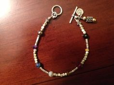 Another of my DIY creations. 925 silver beads interspersed with assorted beads+ gold vermiell bead and a 925 charm.