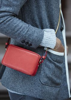 Our mini zip crossbody bag in bright tamale red is the perfect accessory to add a bit of color to your monochromatic cold weather style | Banana Republic