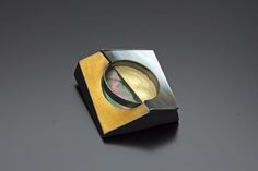 """Shadow"" by Hongsock Lee. 18k yellow gold, sterling silver, keum-boo."