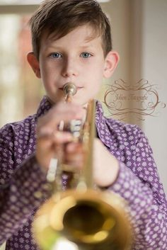 Proud to play the trompet, daylight studio, Natural light photography