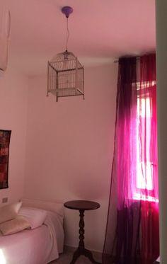 Nuova destinazione d'uso: da gabbia per uccellini a lampadario