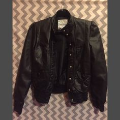 Black faux leather jacket. Wet Seal black faux leather jacket.. Worn a couple times. Very hip and trendy looking!! Size medium from a smoke free home!⚡️ Wet Seal Jackets & Coats