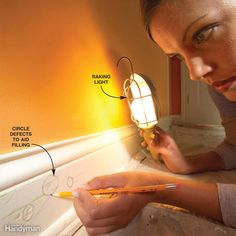 Position a hand-held bulb (at least 60 watts) so it shines across (rakes) the wood surface to detect loose paint, rough edges and other blemishes in the surface to determine what needs to be filled. Take a pencil and lightly circle spots that need work.