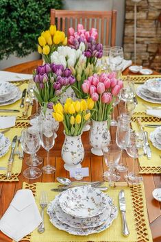 A Rainbow of Tulips in Vases