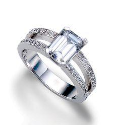 Emerald cut diamond engagement ring.  Gorgeous!