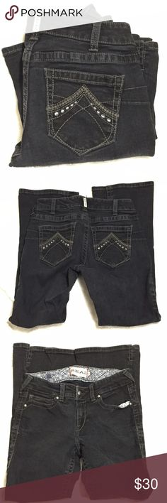 """ARIAT Real Denim Black Jeans Size 30 Short Quality jeans that hold up to lots of abuse.    No crystals or studs, just detailed embroidered rear pockets.    2"""" slit at hem to they will fit over boots.    98% cotton 2% elasthanne.  Machine wash cold and tumble dry low.   Measurements are approximate laying flat. Waist 15"""" rise 8"""" inseam 30"""" width at hem 9"""" Ariat Jeans"""